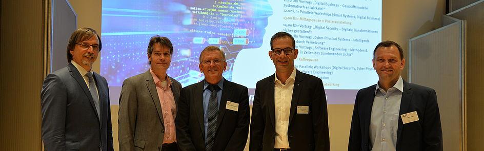 Einführung in das 1. SICP Symposium. v.l.: Prof. Dr. Gregor Engels, Prof. Dr. René Fahr, Christoph Plass und Dr. Stefan Sauer